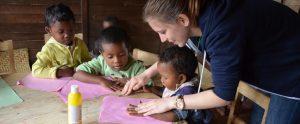 Volunteer with children in Africa