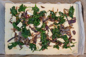 Preparing brie & red onion tart