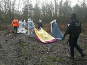 French Police remove refugees, Calais