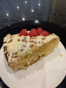 Lemon Drizzle & White Chocolate Cake slice with raspberries
